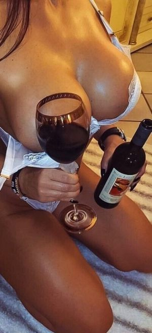 Pic - silly silly enjoys putting faux boobs into glass of wine