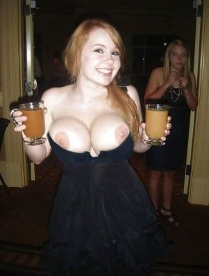 Pic - ginger-haired buxomy hottie at soiree displaying